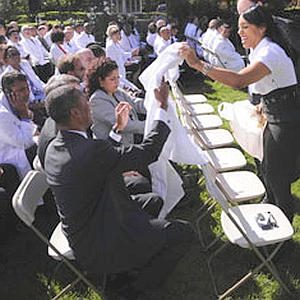Obama handing out white coats to his guest